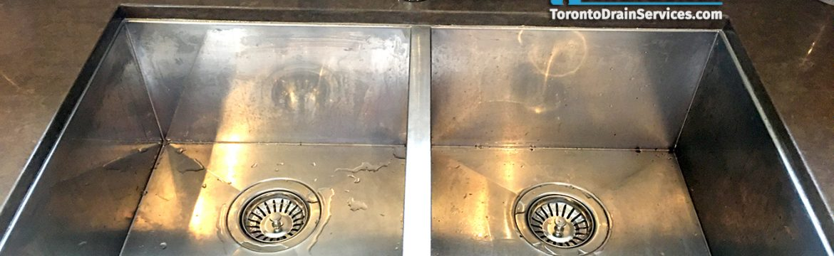 Fallen kitchen sink reattached to granite countertop