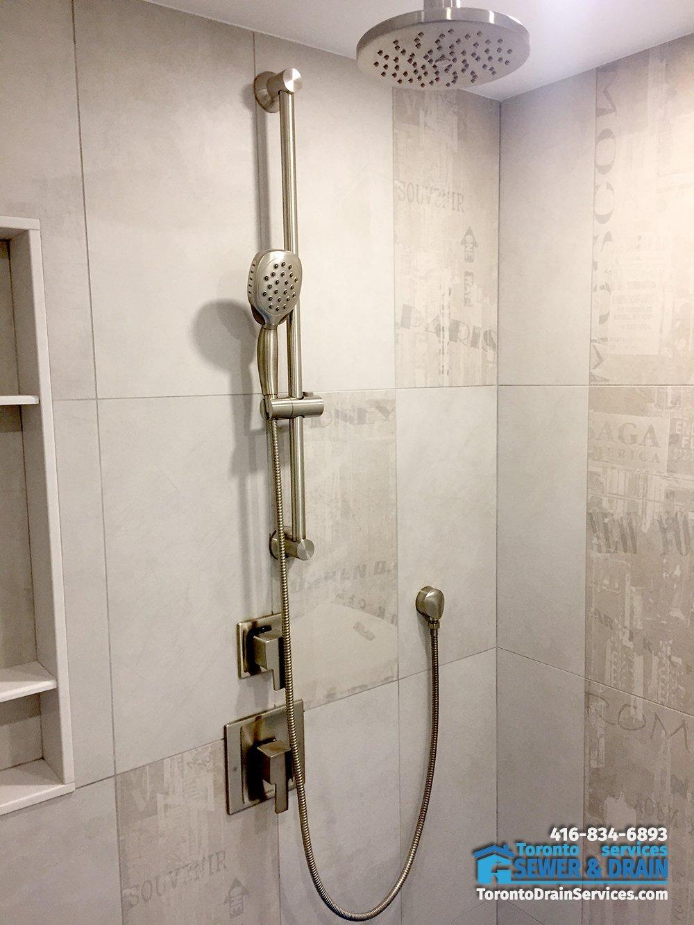 Modern shower faucet installation in Toronto basement